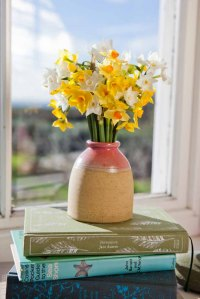 A beatiful vase brimming with narcissi will  brighten up any room